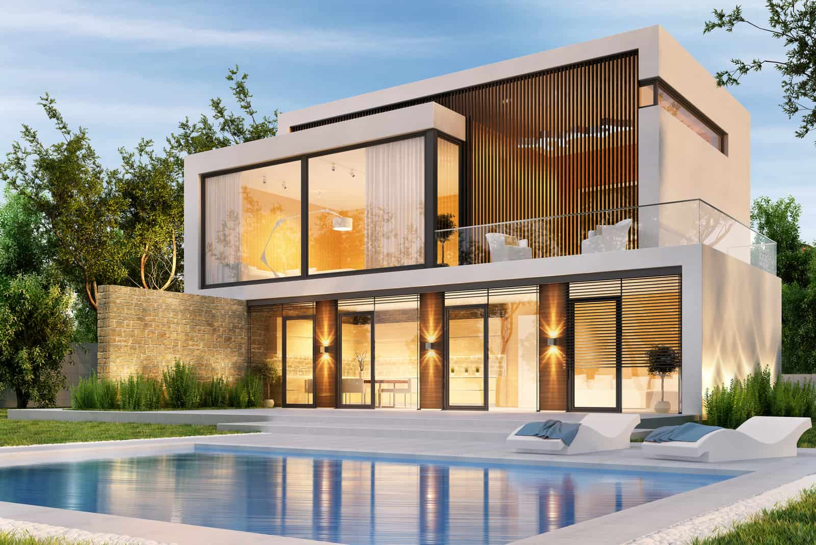 Evening view of a modern large house with swimming pool