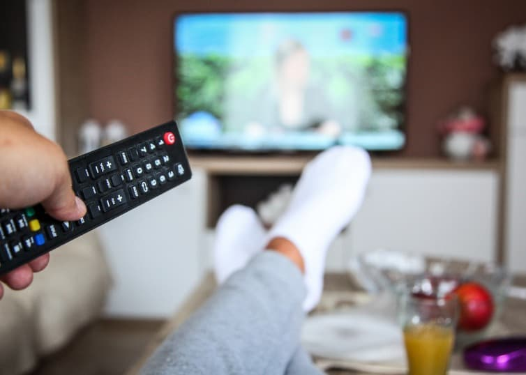 woman watching tv in home
