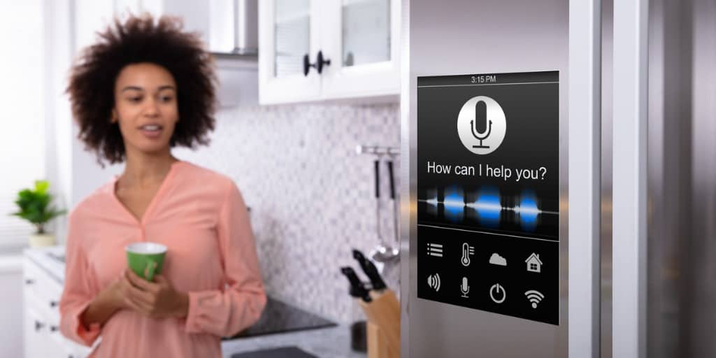 woman standing near the refrigerator with voice recognition