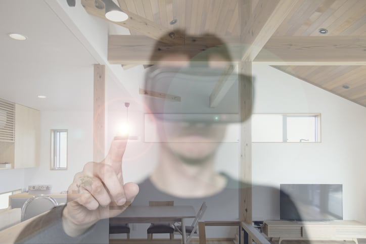 Virtual reality image of person with house.