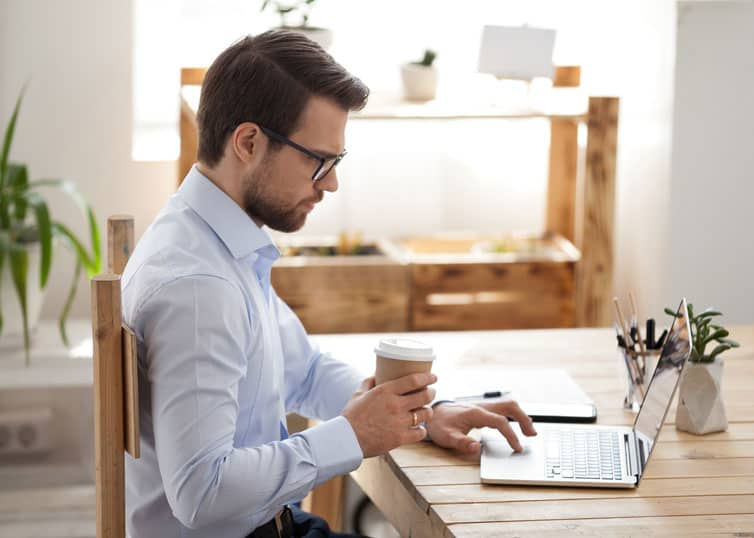 Man researching the costs involved in starting an appraisal business