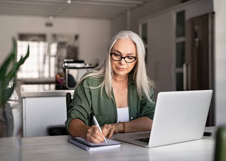 Real estate appraiser writing a report