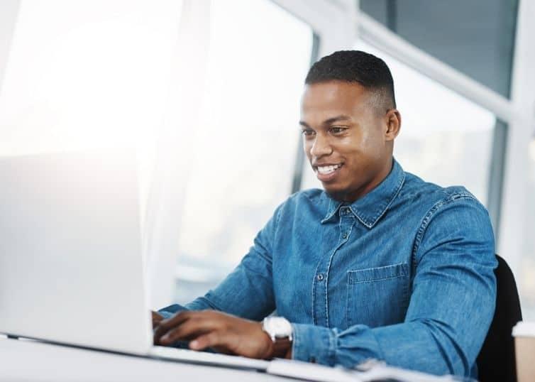 Real estate appraiser working on laptop