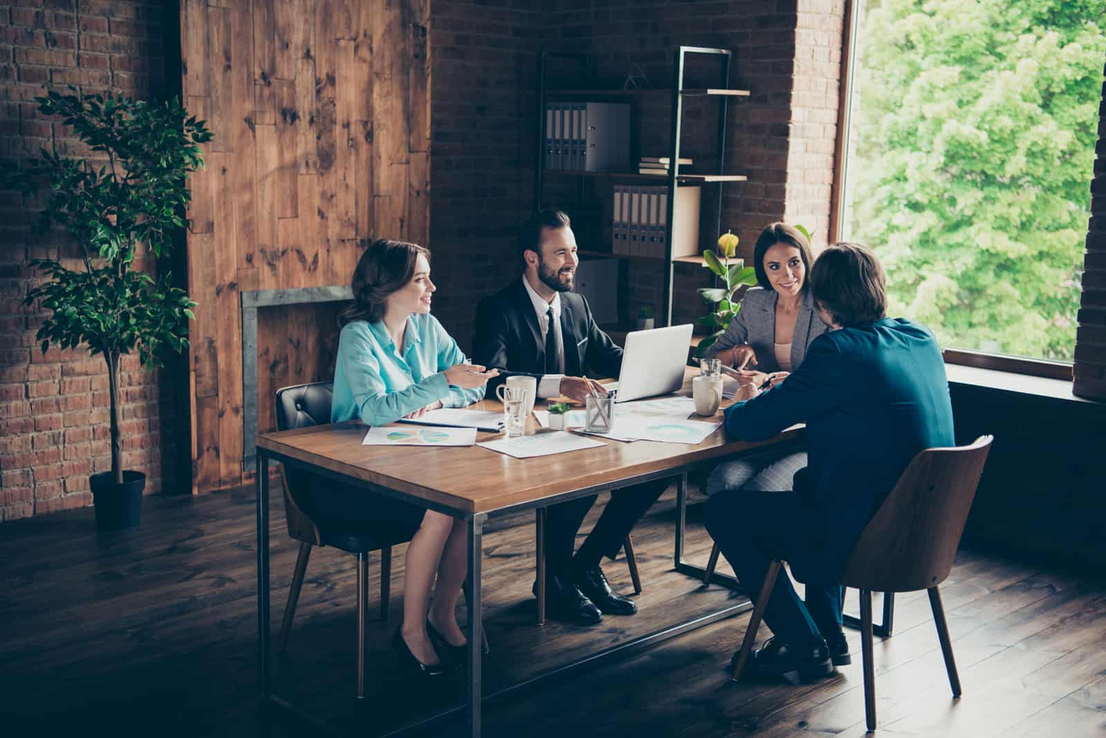 real estate team sitting on table