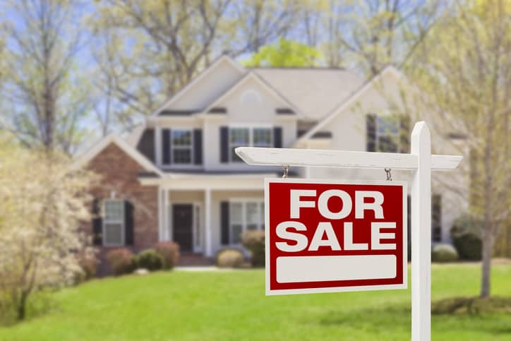 Home For Sale real estate sign in front of single family house