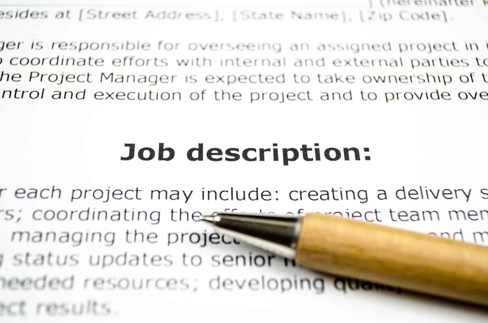 Job description with wooden pen