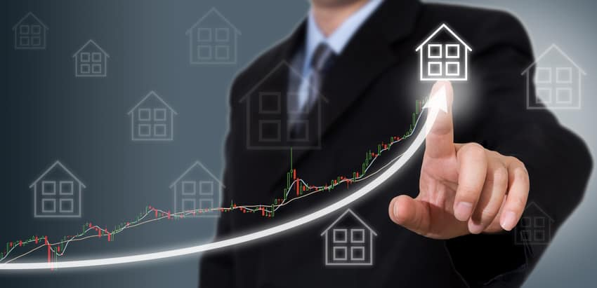 Businessman Touching a Graph Indicating Housing Market Growth