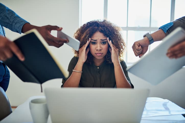 Shot of a stressed out woman facing multiple time management challenges at work